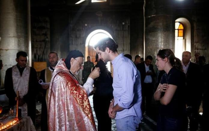 Iraqi Christians Returning Home To Worship In Churches Desecrated By ISIS