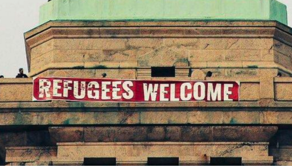 Activists Hang 'Refugees Welcome' Sign From The Statue of Liberty (PHOTOS)