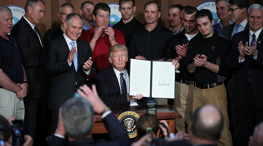 Trump revokes Obama climate change rules, declares end to 'war on coal'